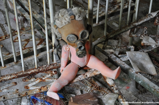 A gas mask-wearing doll in Chernobyl
